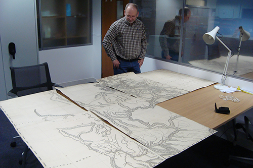 Andreas Korsos inspecting Thompson's Map of the Oregon Territory