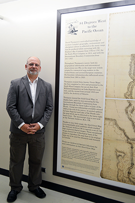 A. Korsos with the map displayed at the Elizabeth Dafoe Library, University of Manitoba